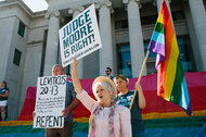 Demonstrators for and against same-sex marriage gathered on Wednesday in front of the Montgomery courthouse as Chief Justice Roy S. Moore of the Alabama Supreme Court testified in the case against him.