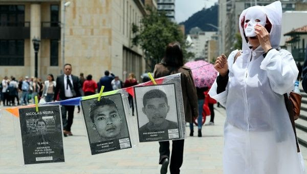 Colombians protest against the murder of social leaders in Bogota.