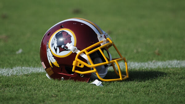 A Washington Redskins football helmet lies on the field during NFL football minicamp.