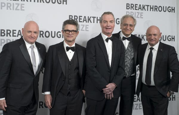 Joseph Polchinski, center, at the NASA Ames Research Center in Mountain View, Calif., with other winners of the 2017 Breakthrough Prize in Fundamental Physics: the physicists Andrew Strominger, second from left, and Cumrun Vafa, second from right. At the far left and far right are the astronauts Scott Kelly and Mark Kelly (Scott's twin brother), who presented the award.