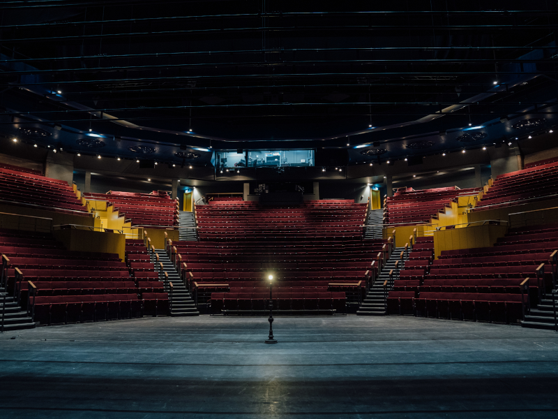 A single ghost light in the centre of Quarry Theatre stage