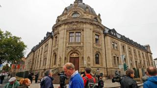 Journalists gather in front of the district court building, prior to the verdict in the trial of Abdul D in Landau, Germany.