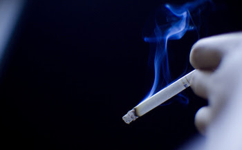 The 2008 Clean Indoor Air Act allows smoking in some bars and restaurants, private clubs and casinos. (DucDigital/Flickr)