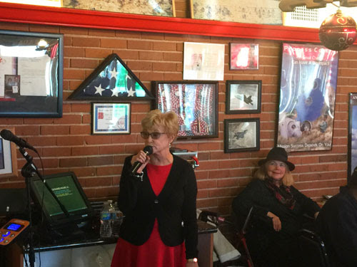 Senator Sharon Runner addressing over 100 veterans receiving a free Christmas dinner at Crazy Ottos Diner in Lancaster