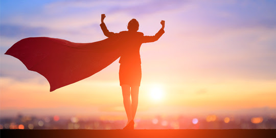 recruiter in a superhero cape flexing muscles