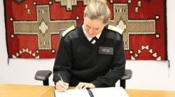 image of a public health officer signing a document