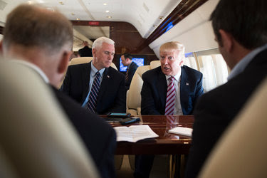 Donald J. Trump and his running mate, Gov. Mike Pence of Indiana, speaking with the news media en route to a campaign event in Youngstown, Ohio, this month.