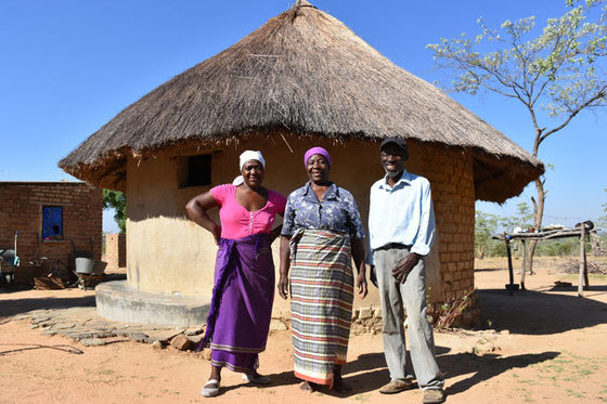 Three of six members of the Madzinga family pose at their homestead in the district of Mutoko in Zimbabwe.