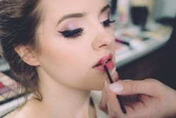 Woman putting on makeup