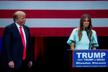 Donald Trump and his wife, Melania, on stage at the Milwaukee Theatre on Monday night for his final rally in Wisconsin, before the state's primary on Tuesday.