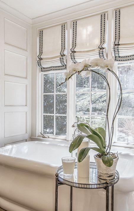Master bath with three roman shades: