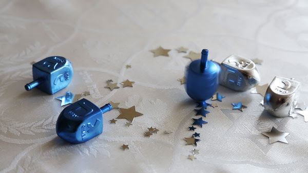 blue-dreidels-slide