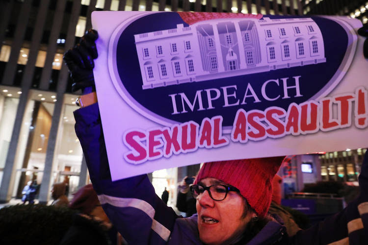 Demonstrators protested last night outside of the Fox News headquarters in New York City to demand the ouster of President Trump after accusations of sexual assault re-surfaced. (Spencer Platt/Getty Images)