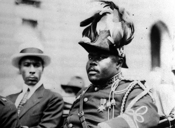 Marcus Garvey, right, at a parade in Harlem in 1922.