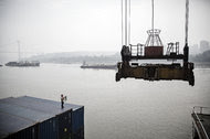 A crane operates next to shipping containers in Chongqing, China. As the Trump administration threatens to impose punitive tariffs on imported goods, American allies are looking to China, which has capitalized on a leadership vacuum in world affairs by offering itself as a champion for global trade and engagement.