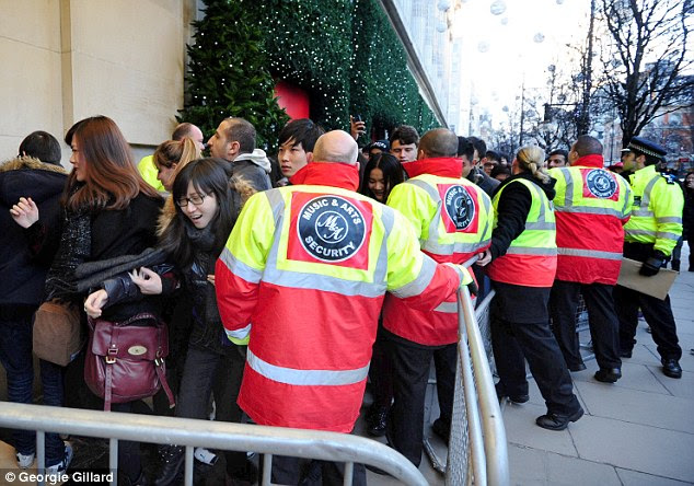Thousands queued to be first through the doors at Selfridges in London on Boxing Day