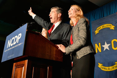 Roy Cooper with his wife, Kristin, at a watch party on Nov. 9 in Raleigh, N.C. Mr. Cooper, the state attorney general, declared victory on election night, but Pat McCrory's allies lodged election challenges in dozens of North Carolina counties.