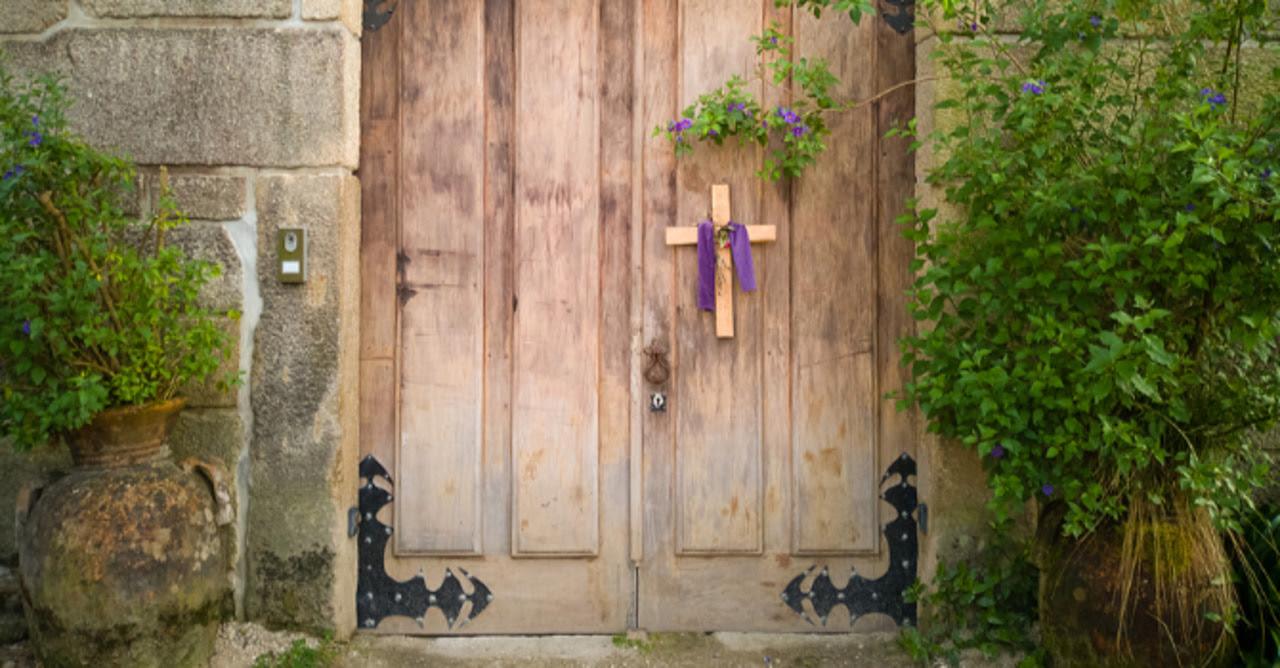Cross draped in purple on a closed church door