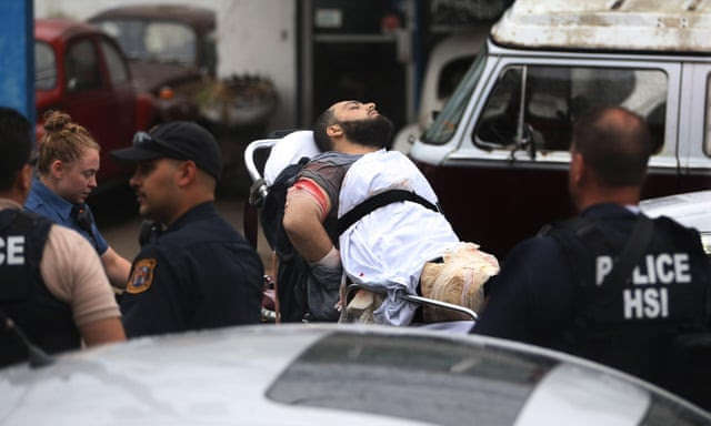 Ahmad Khan Rahami is taken into custody after a shootout with police on Monday in Linden, New Jersey.