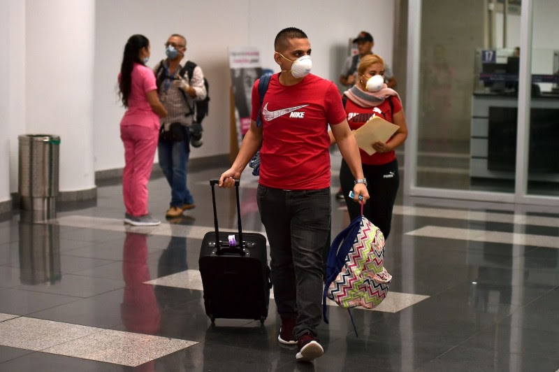 People wear protective face masks as a preventative measure against the spread of the coronavirus.