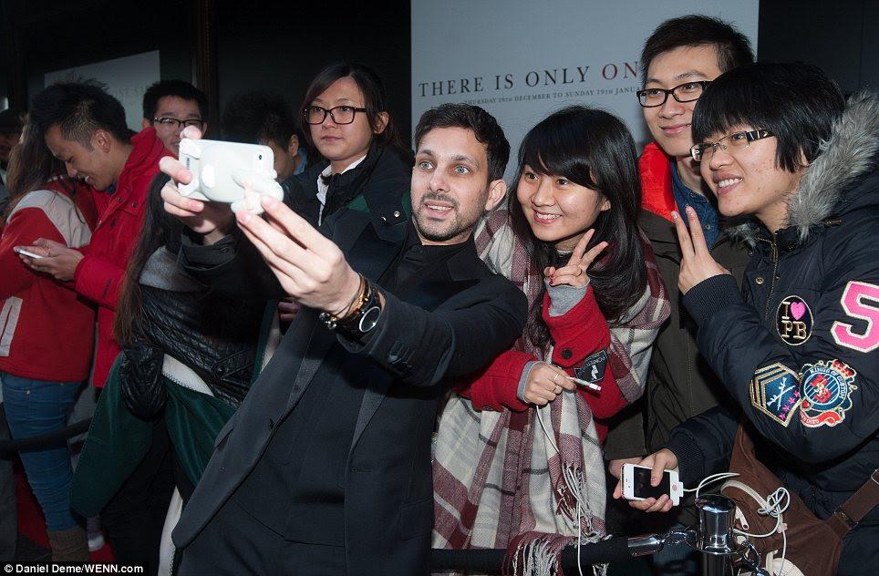 Star: Magician Dynamo taking a selfie with appreciative customers outside Harrods