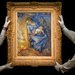 Sotheby's employees hold up Vincent Van Gogh's