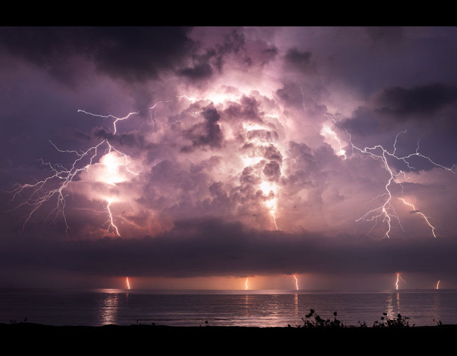 The stunning photographs show the immense lightning piercing the night sky - often in multiple places at once