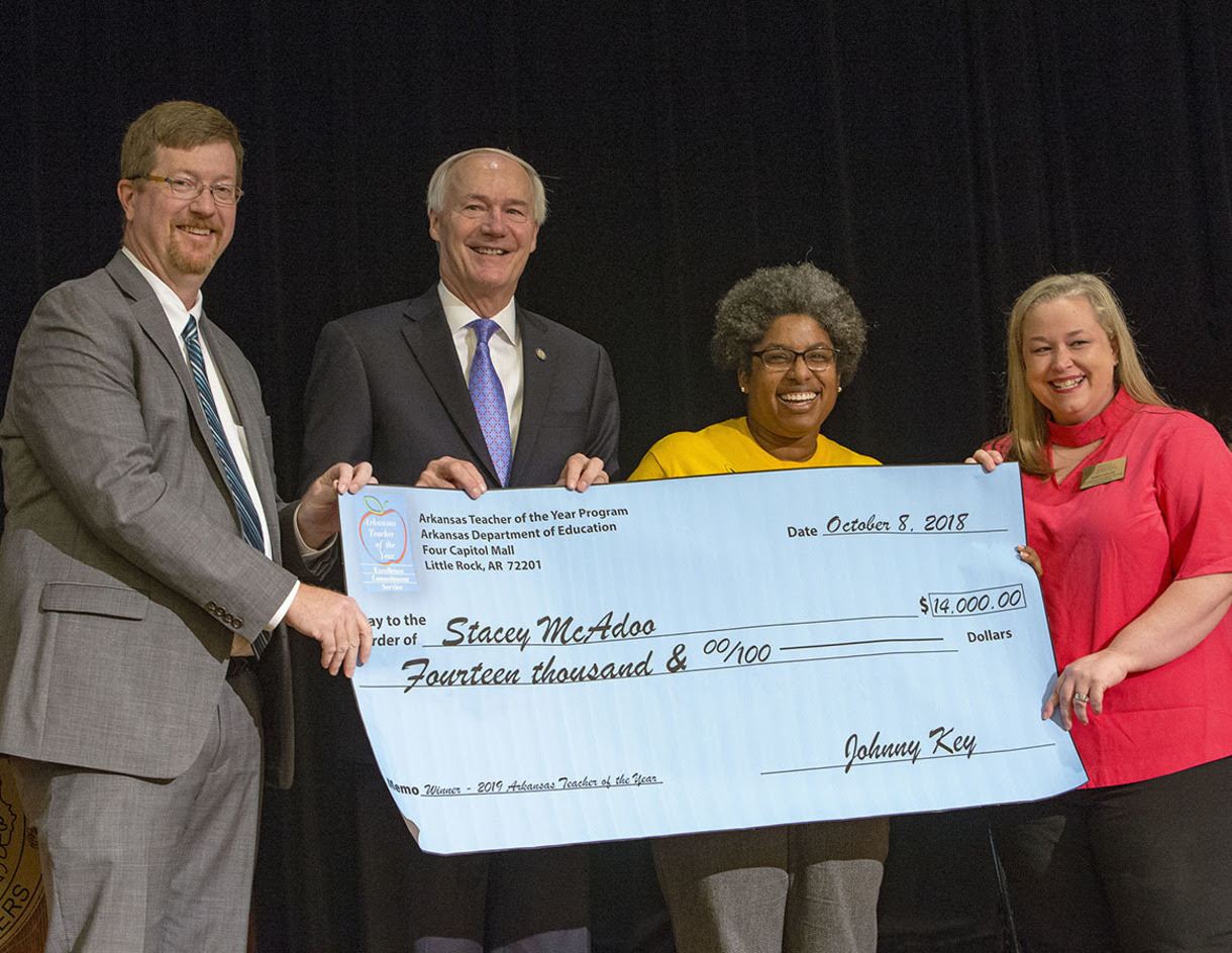 Left to right: Arkansas Department of Education Commissioner Johnny Key, Gov. Asa Hutchinson, 2019 Arkansas Teacher of the Year Stacey McAdoo, and 2018 Arkansas Year of the Year Randi House.