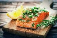 salmon and lemon on a cutting board