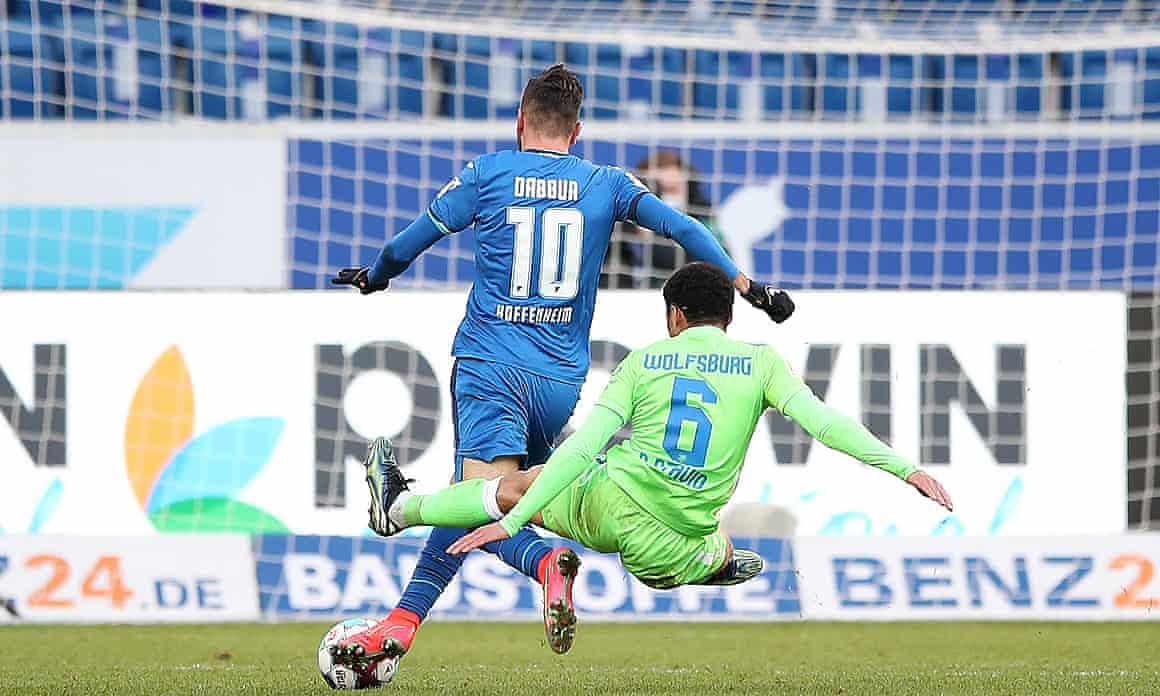 Paulo Otavio hacks down a Hoffenheim player.