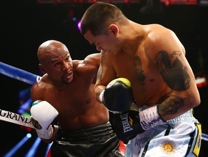 Floyd Mayweather Jr. punches Marcos Maidana during their fight at MGM Grand.