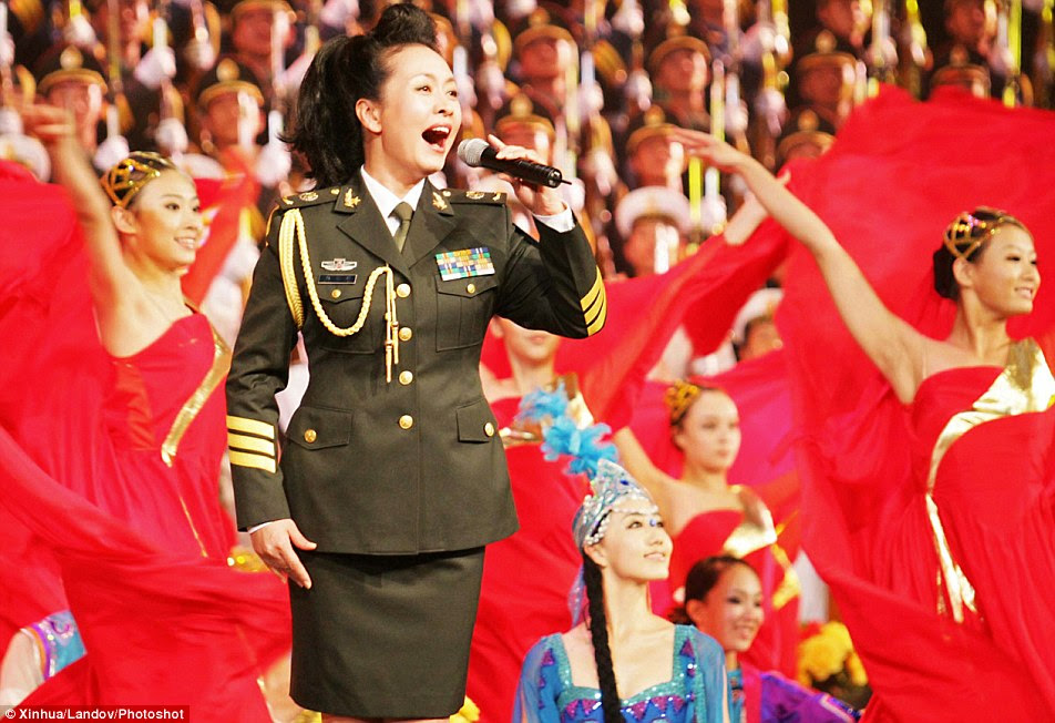 Peng Liyuan, pictured, the presidentâ•˙s second wife, is a former rock star who rose to stardom singing fiercely patriotic anthems