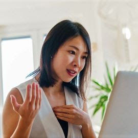 Woman conducting a presentation on her laptop.