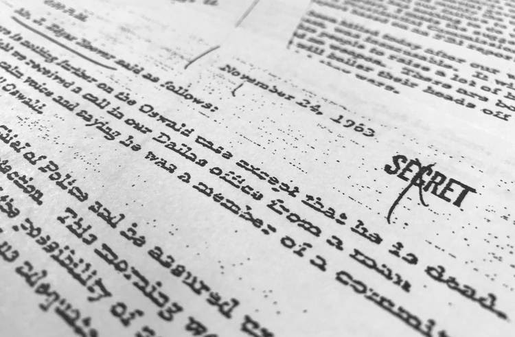 This is a picture of a file, dated Nov. 24, 1963, quoting Hoover as he talks about the death of Oswald, that was released for the first time last night. (Jon Elswick/Associated Press)