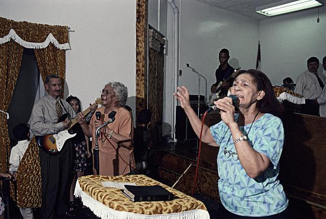 Pura and Juana singing at Senda de Bendicion, 506 Brook Ave., South Bronx, 2001