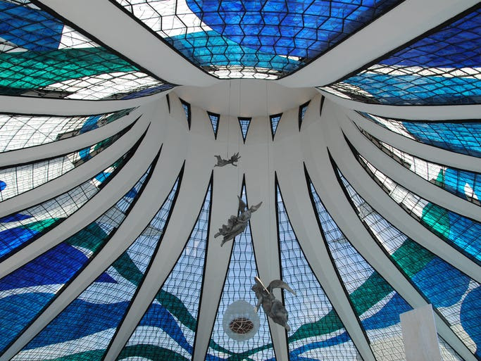 The                                                           interior of                                                           Brasilia's                                                           cathedral                                                           features angel                                                           sculptures                                                           ascending                                                           toward the                                                           colored-fiberglass                                                           ceiling.