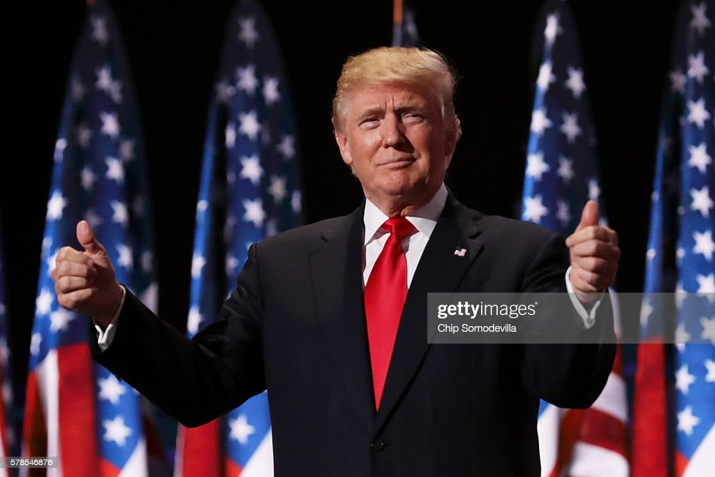 Republican presidential candidate Donald Trump gives two thumbs up to the crowd during the evening session on the fourth day of the Republican National Convention on July 21, 2016 at the Quicken Loans Arena in Cleveland, Ohio. Republican presidential candidate Donald Trump received the number of votes needed to secure the party's nomination. An estimated 50,000 people are expected in Cleveland, including hundreds of protesters and members of the media. The four-day Republican National Convention kicked off on July 18.  (Photo by Chip Somodevilla/Getty Images)
