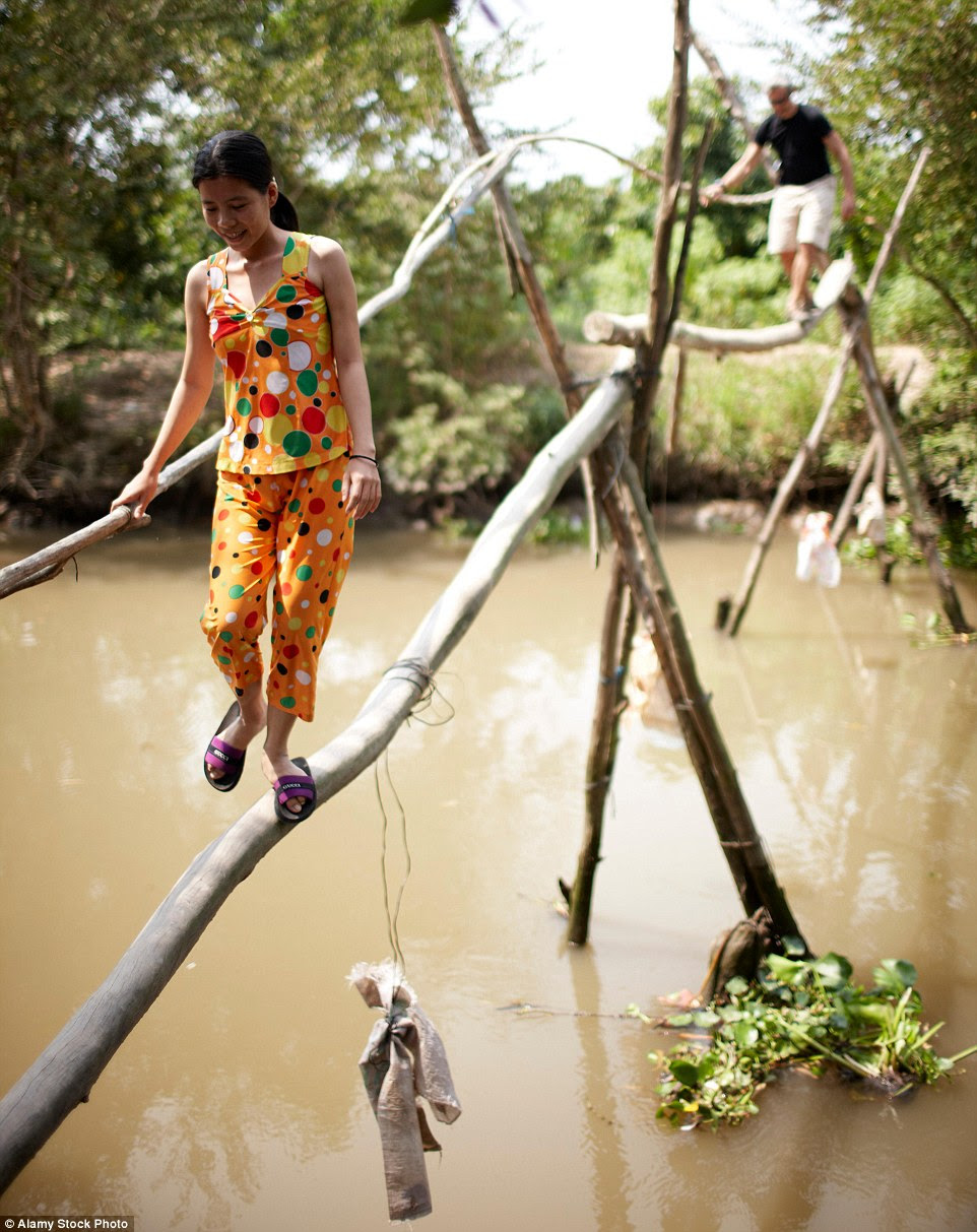 If                                                      you are heavy                                                      footed, you may                                                      wish to find an                                                      alternative way                                                      across the rivers                                                      in Vietnam. Monkey                                                      bridges include                                                      one giant log for                                                      your feet, and                                                      another smaller                                                      one for your                                                      hands