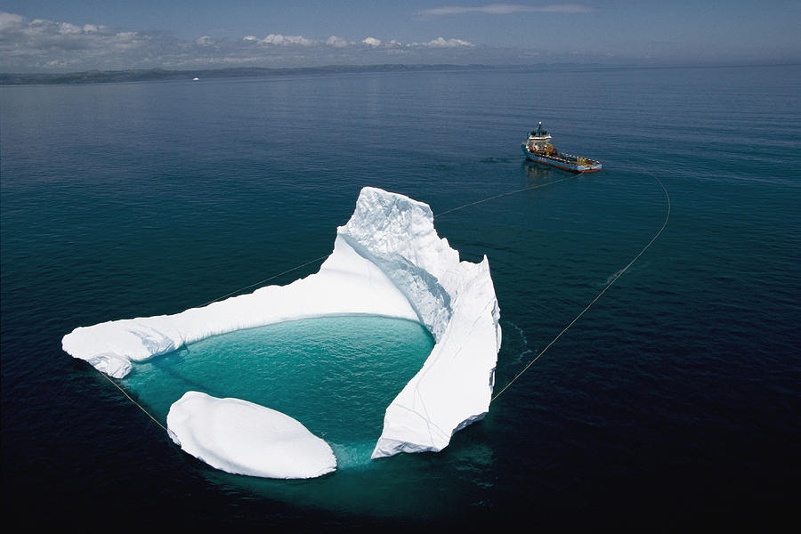 Towing an        iceberg    offshore    Newfoundland