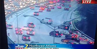 television screen showing news coverage of Atlanta snowstorm