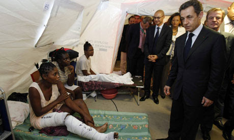 President Sarkozy speaks to an earthquake survivor in Haiti