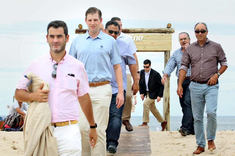 Eric Trump and members of his Secret Service detail walk outside a beachfront restaurant during a private business trip last month to Uruguay. (Cristian Cordoba)</p>