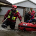 Rescue workers evacuated residents from homes near the River Thames on Monday.