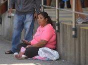 A woman waits outside the Jose Rodriguez Infectology Hospital, Guayaquil, Ecuador, April, 03, 2020.