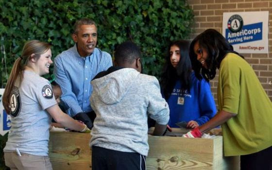 President Obama and The First Lady serve with Americorps members at Leckie Elementary on MLK Day