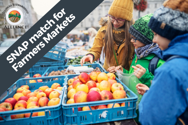 Help connect SNAP Match programs and users with farmers. A photo of three young people at a farmer's market stand choosing apples with the Alliance logo in upper left.