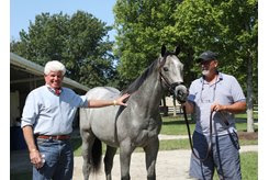 (L-R): Allen Poindexter and Tim Hamlin with the Frosted colt consigned as Hip 298 at the Fasig-Tipton Selected Yearling Showcase