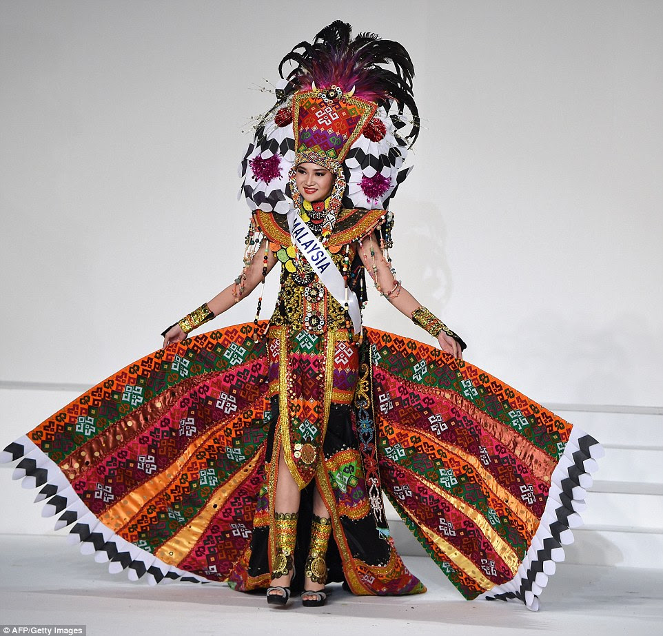 Miss Malaysia was all about the textiles, wearing a heavily embroidered multi-coloured dress lined with gold. The aptly named Immaculate Lojuki dangled with coloured beads as she held out the wings to her skirt, the width balanced by samurai-eque shoulder pads and a flamboyant headdress with feathers and black and white flowers with sparkly pollen