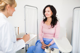 Woman in exam room with doctor