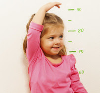 Child next to growth chart
